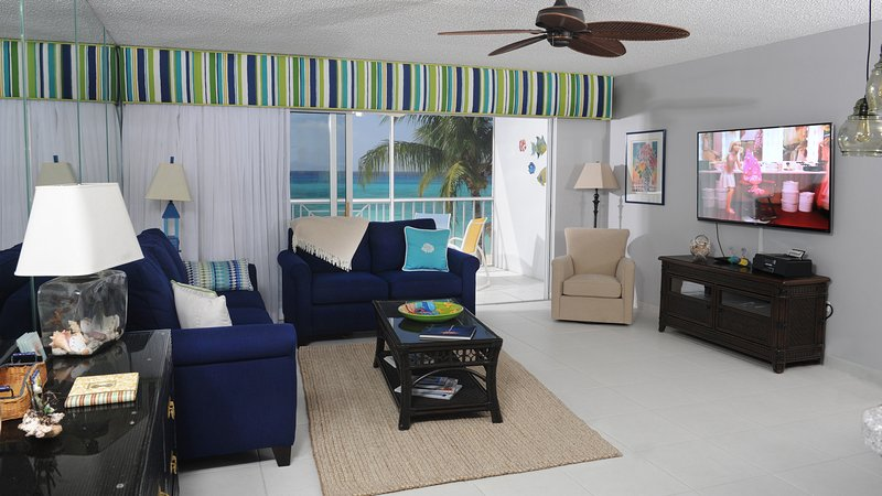 Spacious Living Room with Smart HD TV - Oceanfront directly on 7 Mile Beach - Email for Specials! - Seven Mile Beach - rentals