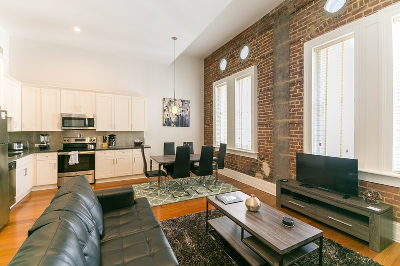 Factors Row by Stay Alfred Living Area - Updated Carondelet Street Apartment by Stay Alfred - New Orleans - rentals