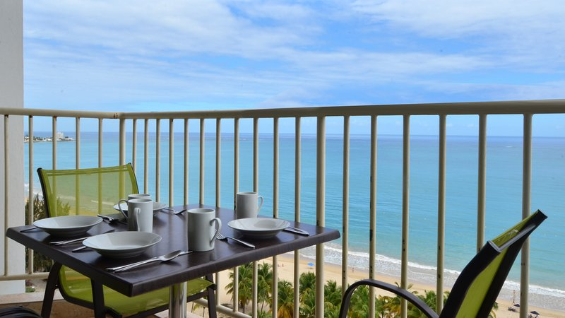 Enjoy a relaxing meal while admiring the view. - Overlooking Isla Verde Beach, Steps to Casinos - Isla Verde - rentals