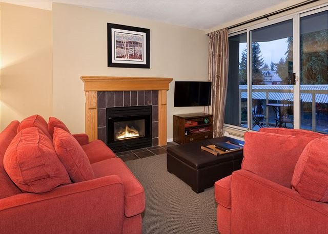 Cozy Living Area with Gas Fireplace - Woodrun Lodge #211 | 2 Bedroom & Den, Ski-In/Ski-Out Access, Shared Hot Tub - Whistler - rentals