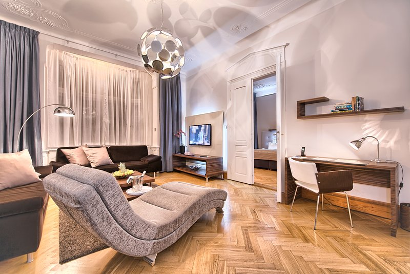 Spacious living room with comfortable sofas and a working desk - Jewish Town - Executive 2bdr | Brehova Residence - Prague - rentals