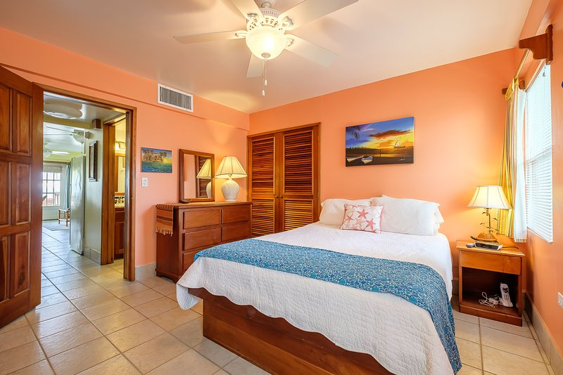 Bright and beautiful bedroom adorned with local artwork! - Adorable 1 bedroom condo on private beach! -A3 - San Pedro - rentals