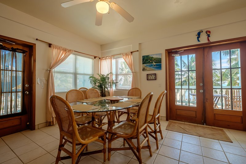 Bright dining area with beautiful views and french doors leading to second floor balcony! - 3 bedroom condo on your own private beach! -B2 - San Pedro - rentals