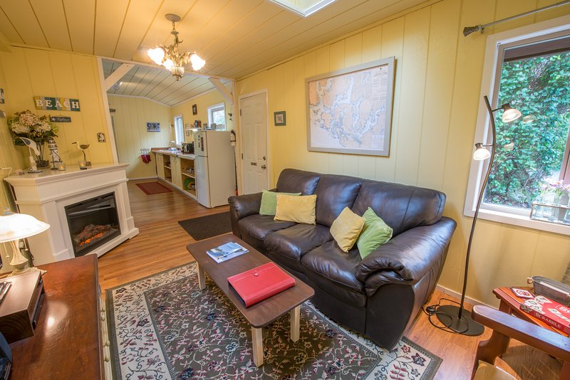 Living Room with Fireplace, TV/DVD/Wifi, Books and Games - Surf Shack Cabin by the Beach with Private Hot Tub - Tofino - rentals