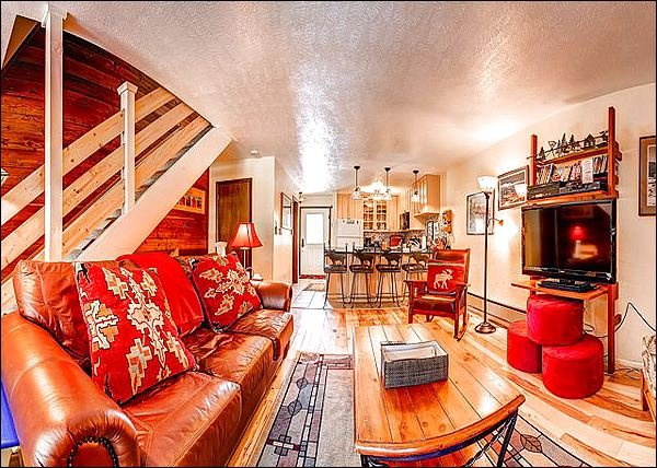 Elegant Living Room has a Large Flat Screen HDTV and Hardwood Floors - Close to Snowflake Lift and Main Street - Stylish Mountain Charm & Lovely Views - Breckenridge - rentals