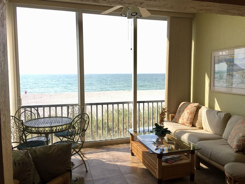 Open Lanai with sofa, chair and table set to watch the beach, sunset and wildlife. - Gorgeous Direct gulf Front 2 Bedroom Condo on Siesta Keys... JUST REMODELLED - Siesta Key - rentals