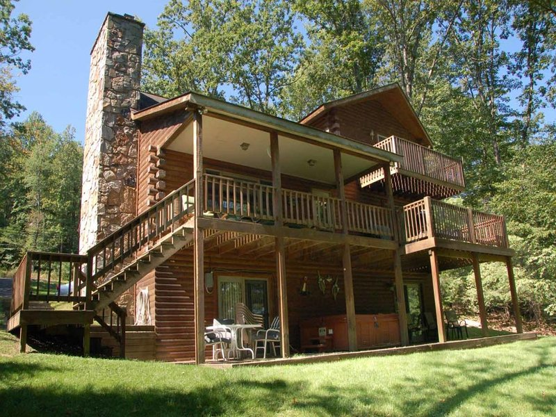 advbouext_11.jpg - You'll stay busy at Adventure Bound!  Here, you can spend easy mornings on the dock, hop in the hot tub, or curl up by the fire- whatever your heart desires. - McHenry - rentals