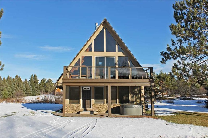 Located at Base of Powderhorn Mtn in the Western Upper Peninsula, A Gorgeous Modern Home with Heated Entryway & Brick Fireplace - Image 1 - Ironwood - rentals