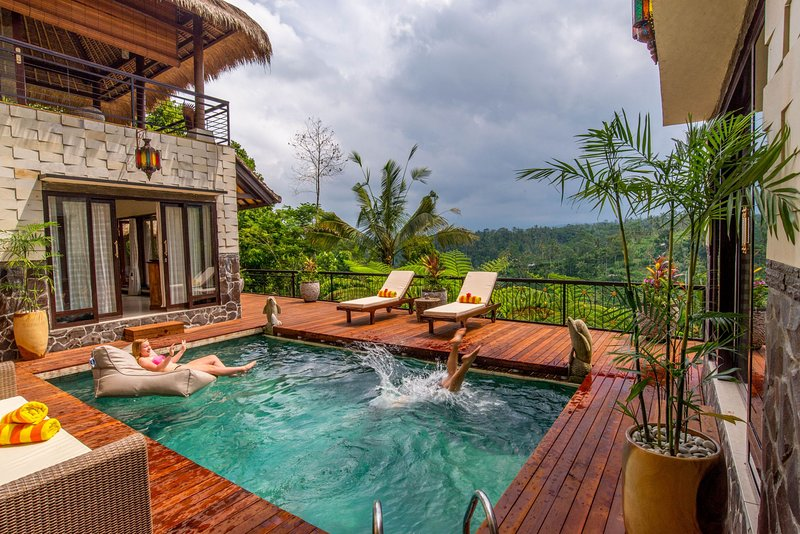 Enjoy your heated swimming pool with brand new wooden deck and furniture. Water - Hillside Eden Private Jungle Estate - Stunning Service, Amazing Views! - Ubud - rentals