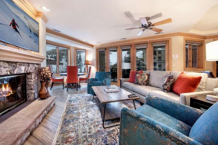 Living room with views of Strawberry Park, wood burning fireplace, large curved flat screen TV/Blu Ray DVD. - Beaver Creek Lodge Condo, Steps to Lifts, Shopping and Dining, Year Round Pool - Beaver Creek - rentals
