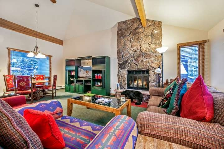 Inviting living area with wood burning fireplace and game table for 4. - Eagle-Vail Duplex, Nordic Trails in Winter, Biking Trails in Summer, Convenient to Vail or BC! - Eagle-Vail - rentals