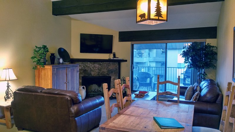 BC West Condo L-4 living room with sofa bed, wood fireplace, dining table, and balcony w/ gas BBQ - BC West L-4 w/ FREE skier Shuttle - Avon - rentals