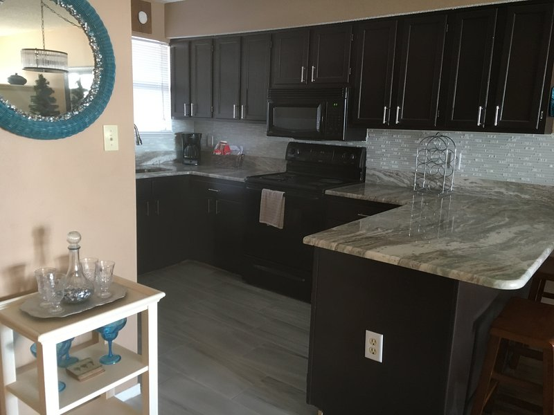 Gorgeous views from the spacious  kitchen.  New Granite, Tile and back splash - SEASCAPE Orange Beach, Alabama, Gorgeous Gulf view! Beautiful new granite. - Orange Beach - rentals