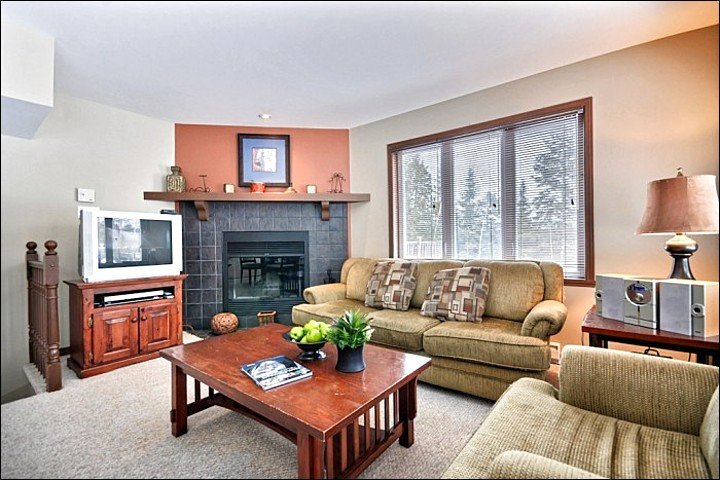 The Spacious Living Area Features a Cozy Wood Burning Fireplace - Cozy Furnishings and Decor - Spacious Balcony with Summer BBQ (6020) - Mont Tremblant - rentals