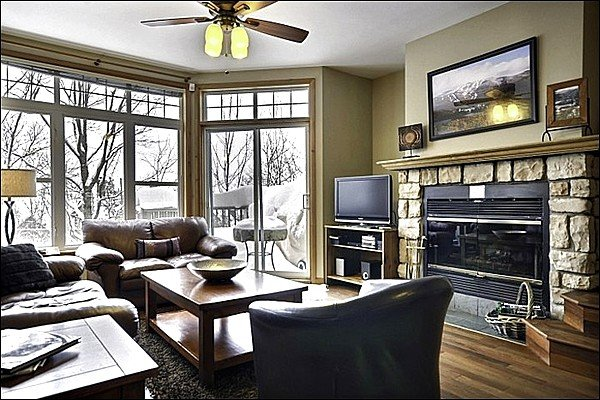 Living Room Features Large Windows and a Cozy Stone Fireplace - Lovely Views of Mont Tremblant & Village - Spacious Layout and Tasteful Decor (6023) - Mont Tremblant - rentals