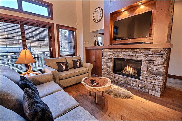 Stylish Living Room Features a Stone Fireplace and Flat Screen TV - Recently Built and Professionally Decorated - Heated Floors in the Kitchen and Bathrooms (6057) - Mont Tremblant - rentals