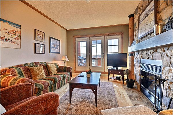 The Cozy Living Area is Stunning with the Inviting Furnishings - Magnificent Lake and Mountain Views - Common Hot Tub (6068) - Mont Tremblant - rentals