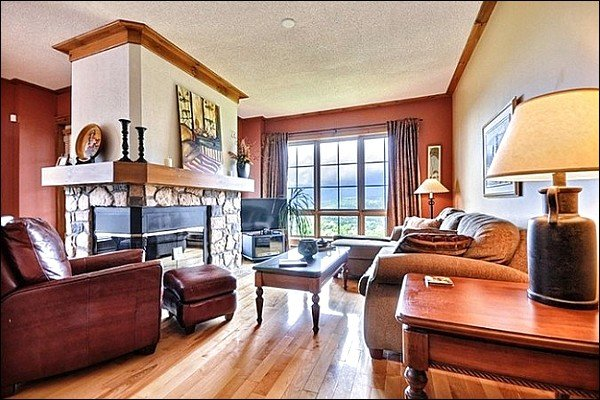 Beautifully Living Area with Stone Fireplace - Breathtaking Mountain Views from Private Balcony - Upscale Decor Throughout  (6073) - Mont Tremblant - rentals