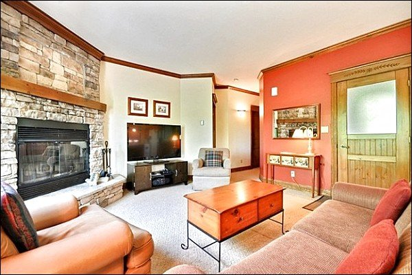 Elegant Living Room Features a Large Flat Screen HDTV and Stone Fireplace - Perfect for Nature Lovers - Tastefully Decorated & Conveniently Located (6094) - Mont Tremblant - rentals