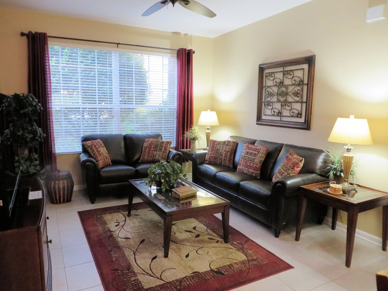 Living room upgraded in 2016 with new leather furniture and decor. - Windsor Hills 3BR-2BA Condo - 2 Miles from Disney - Kissimmee - rentals