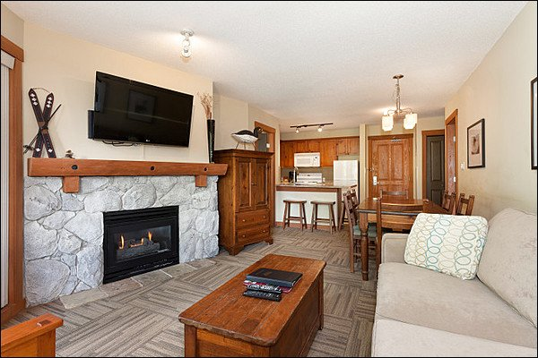 Modern Living Room Features a Cozy Stone Fireplace - Lovely Golf Course and Forest Views - Located on Free Shuttle Route (4030) - Whistler - rentals