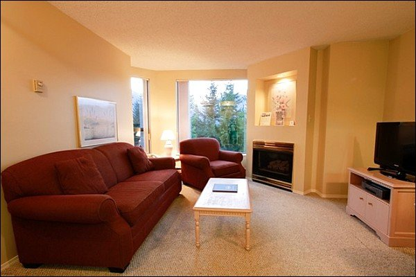 The Living Area Includes a Gas Fireplace, TV and Queen Sleeper Sofa - Shared Fitness Room and Sauna - Underground Parking (4039) - Whistler - rentals