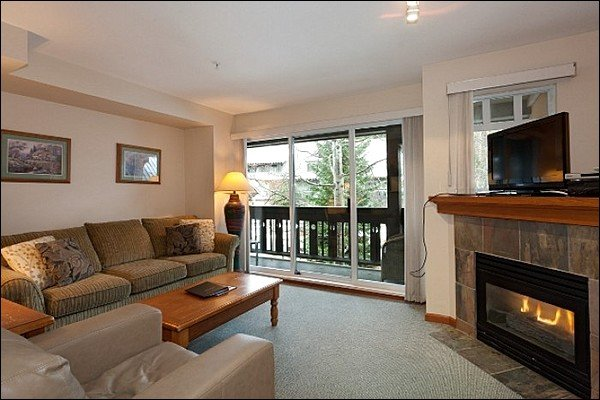 Living Area Offers Fireplace and Access to Balcony - Gas Fireplace - Beautiful Mountain Views (4049) - Whistler - rentals