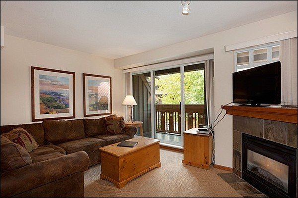 Cozy Living Room with Flat Screen TV, Gas Fireplace & Private Balcony Access - Common Area Outdoor Pool & Hot Tub - Short Walk to All Village Attractions (4061) - Whistler - rentals