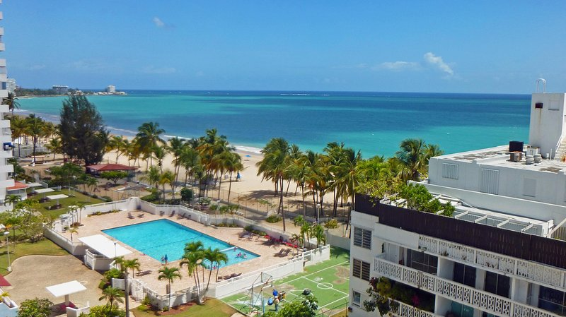 View from the balcony. Sun, sea and sand - and a pool.  What more to ask for? - Direct on Isla Verde Beach, Steps to Casinos - Isla Verde - rentals