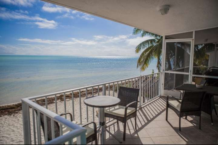Balcony with seating for 4 overlooking the private beach - **April Discounts!** Rare Ocean Front Keys Home with Private Beach - Great for - Islamorada - rentals