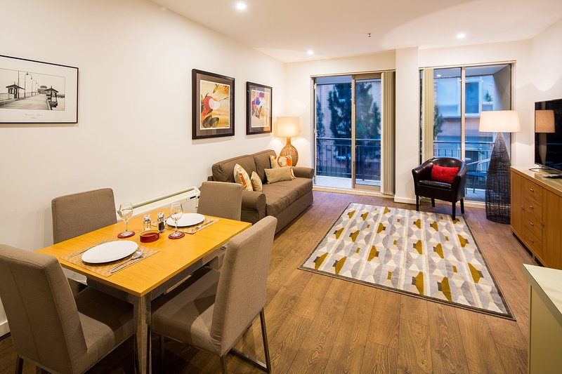 "Catani 1 Living area - now with 60"" UHD Smart TV - StayCentral Catani 1 St Kilda Serviced Apartment - St Kilda - rentals"