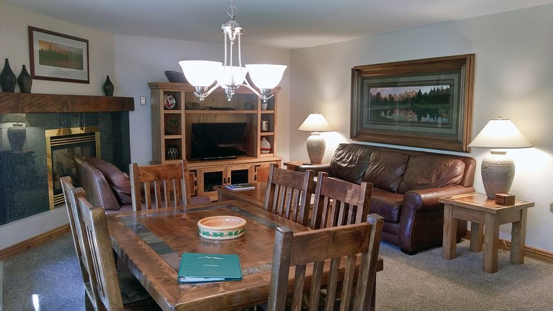 BC West Condo V-2 living room with sofa bed, gas fireplace, dining table, and balcony w/ gas BBQ - BC West V-2 w/ FREE Skier Shuttle - Avon - rentals