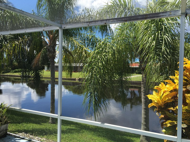 Beautiful Canal front views, tropical palms & breathless sunsets from lanai! - Waterfront 3/2,Yacht Club Pet Friendly Home - Cape Coral - rentals