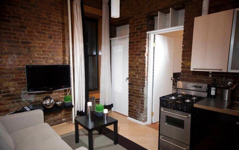 Exposed Brick Detailing - Comfortable 2 Bedroom, 1 Bathroom Apartment in SoHo - Image 1 - New York City - rentals