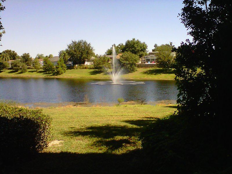 The wonderful view of the lake and fountain from our condo - Orlando condo at Legacy Dunes  - resort amenities - Kissimmee - rentals