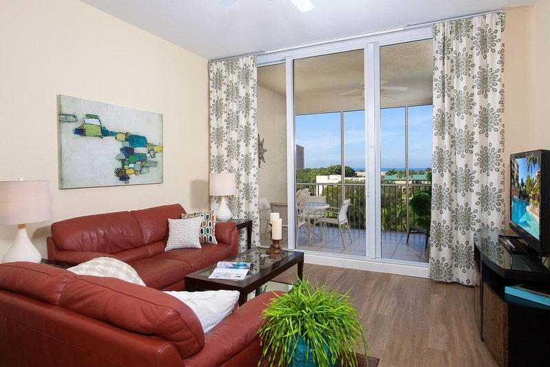 Spacious Living room with large screen TV, ocean and pool views. - 3 Bdrm at Vanderbilt Beach - Perfectly relaxing - Naples - rentals