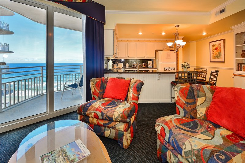 Living Room overlooking Private Balcony - Wyndham Ocean Walk-Updated-Local Owner Manager - Daytona Beach - rentals