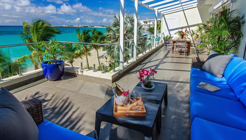 The view of the terrace and beach when sitting on the sofa (now covered with roof) - Le Papillon - Modern Beachfront Unit, stunning view, great amenities - Simpson Bay - rentals