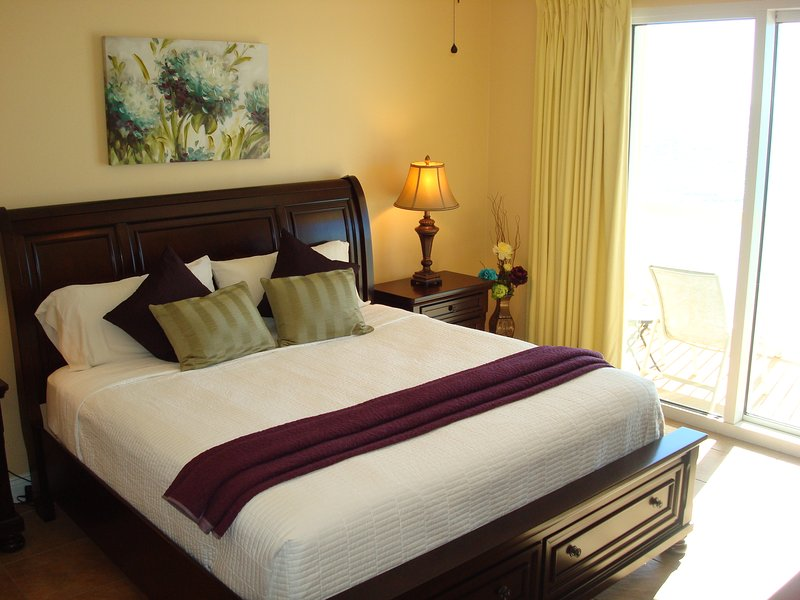 Tranquil master bedroom with king size bed and access to private balcony - 2017 BREAK @CALYPSO! 7th Flr, FREE Bch Chrs&WIFI - Panama City Beach - rentals