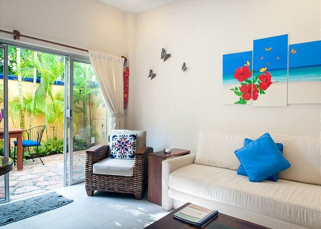 Foldout sofa bed and relaxing reading chair - Modern, comfortable well appointed apartment with private garden courtyard. - Puerto Morelos - rentals