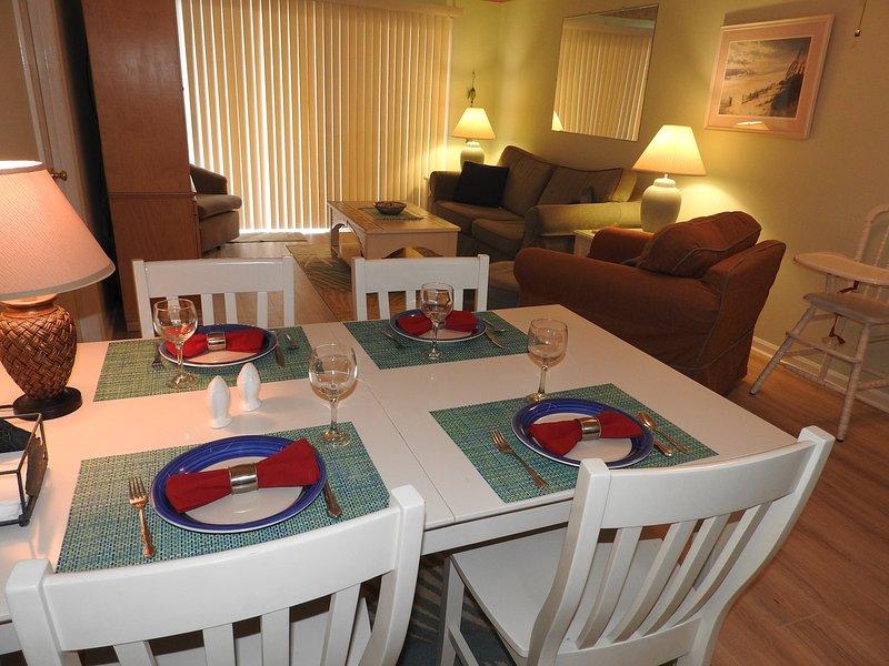 Living Room and Dining Area - Sands IV Unit 1A Beautifully Upgraded Condo - Carolina Beach - rentals