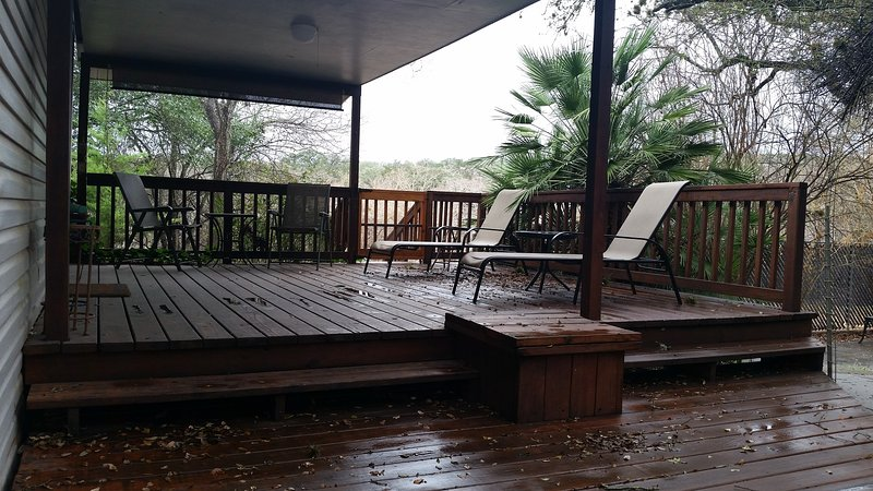 Deck from the back yard. - Paradise River Retreat_ Call Shannon 830-358-6111 - New Braunfels - rentals