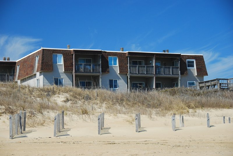 Exterior View Facing East to the Beach Access  - Oceanfront Condo in Regency Newly Renovated MP 9.5 - Kill Devil Hills - rentals