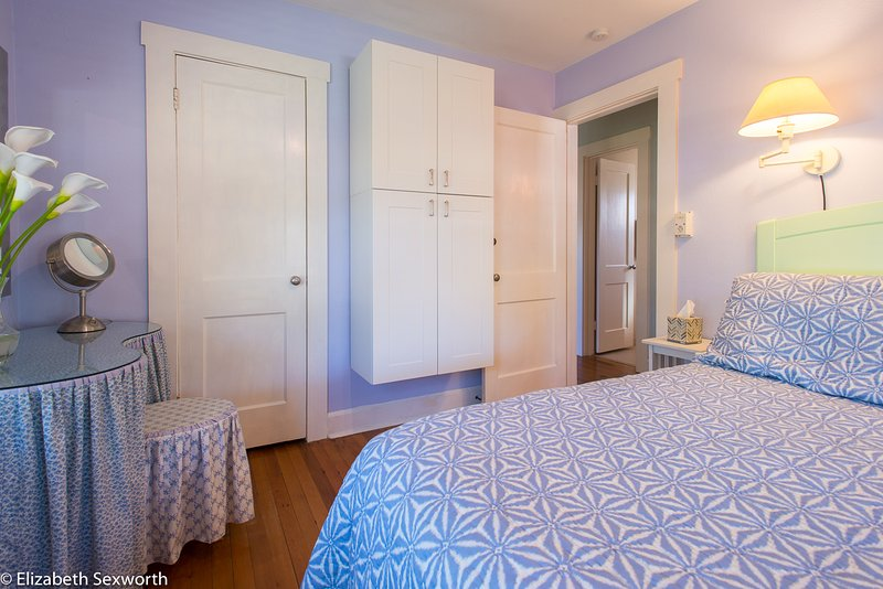 Master bedroom has queen bed, mounted cabinets, vanity, closet, TV, dresser, Annie Selkie linens - Palm Cottage:Vintage Tropical Hideaway in the Waterfront District - Gulfport - rentals