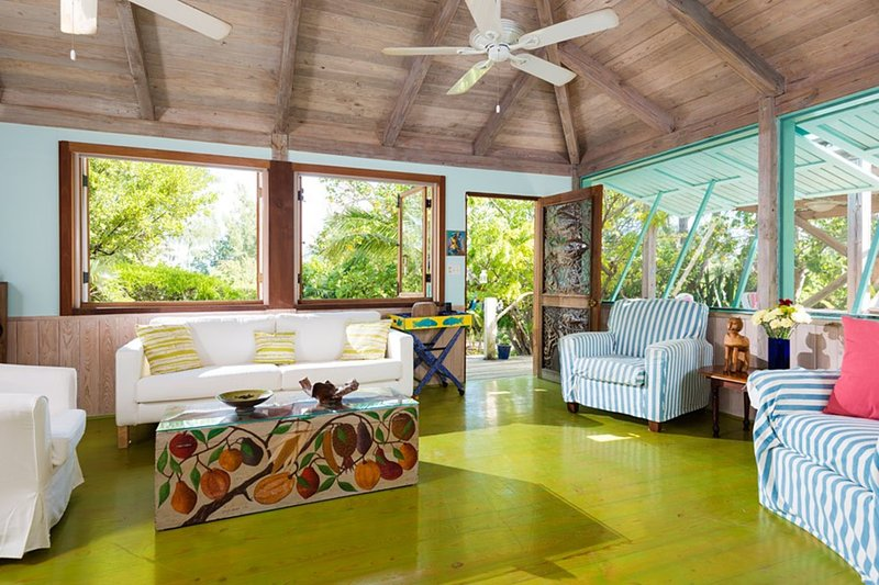 Livingroom heading out to the  porch, on to the beach path & Yoga deck.Moon towe - Artists bungalows in a garden oasis yoga deck 190 pace path to Grace Bay... - Leeward - rentals