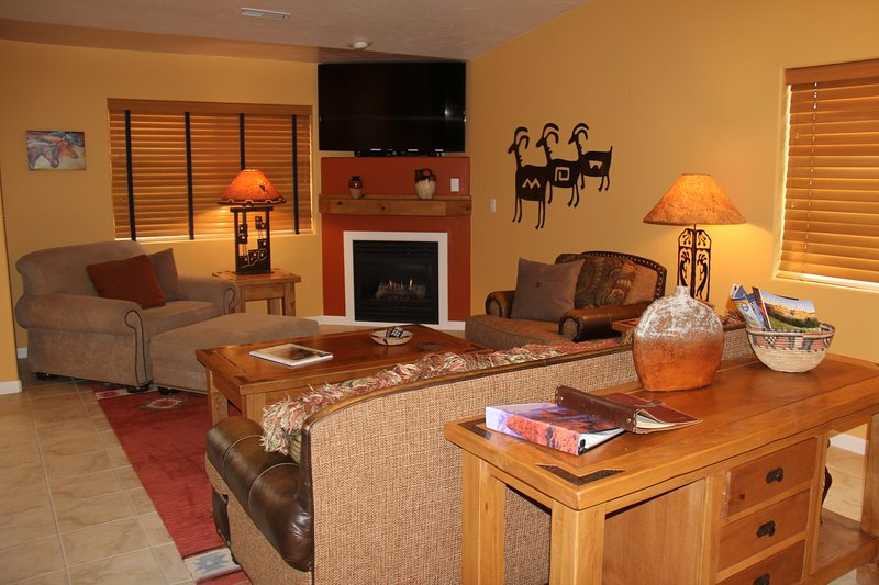 Large living area with gas fireplace and large TV! - BLUE JOHN - NEW LISTING!  POOL/HOT TUB/PING PONG! - Moab - rentals