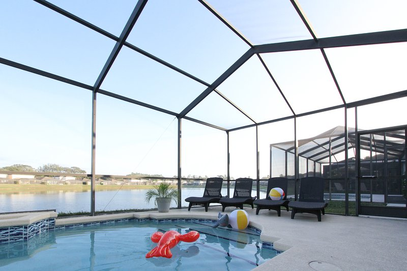 Late afternoon lakeside relaxation! - Tropical Lakefront Villa, Pet-Friendly and only 5 mins to Disney - Kissimmee - rentals