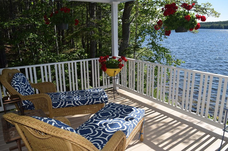 While away a summer afternoon on a lovely, flower-bedecked porch with views of the lake. - Classic Shingled Lakeside Cottage on Maine's Beautiful Down East Coast - Sedgwick - rentals