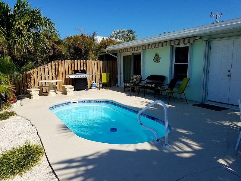 View of pool, patio furniture, gas grill and roll out auto 18x10 awning 4 shade. - 3 BDRM - POOL - 1 MIN WALK TO BEACH - DOCK -DAILY SUNSETS - 4/22-5/27 $1,695 WK - Key Colony Beach - rentals