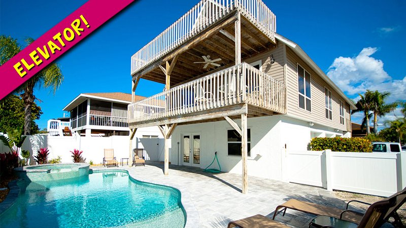 Convenient Elevator Next to Front Door - Starfish Villa: 2BR Pool Home w/Elevator - Holmes Beach - rentals